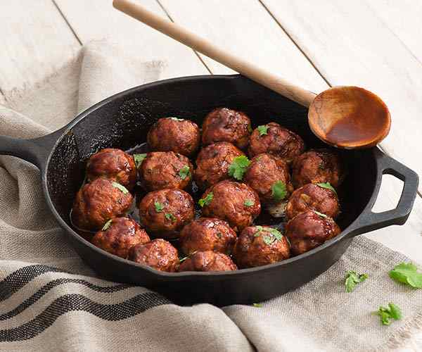 Photo of - Cheddar-Stuffed Meatballs with Sriracha Glaze