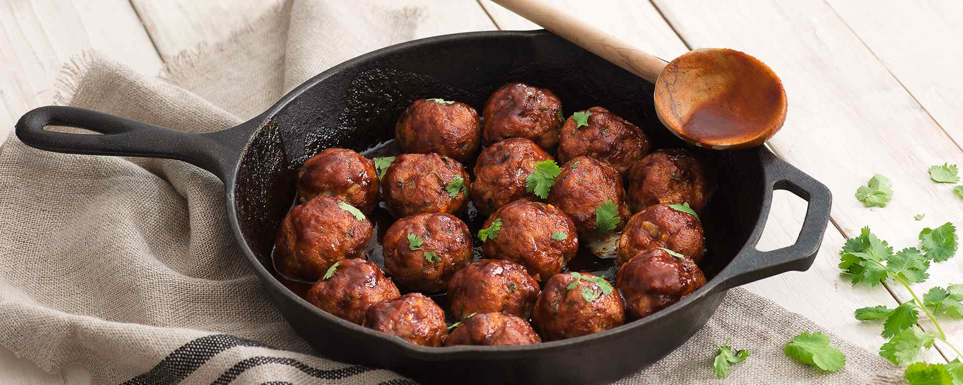 Photo for - Cheddar-Stuffed Meatballs with Sriracha Glaze