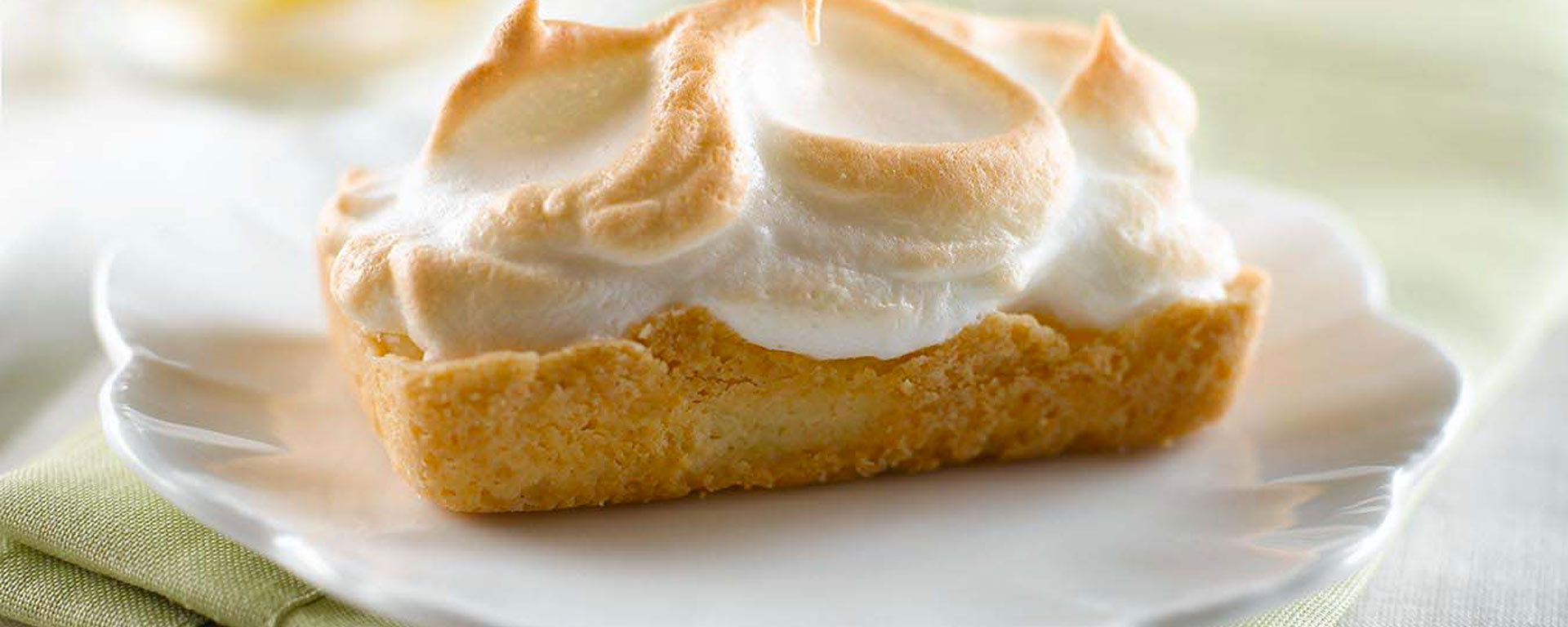 Photo for - Sour Cream Lemon Meringue Shortbread Tarts