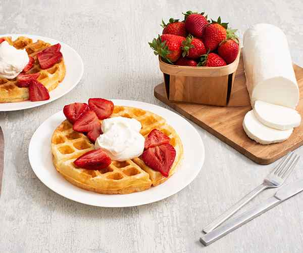 Photo of - Buttermilk Waffles with Balsamic Roasted Strawberries and Goat Cheese Whipped Cream