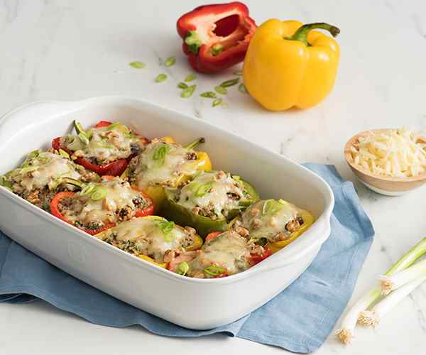 Photo of - Cheesy Quinoa-Stuffed Peppers
