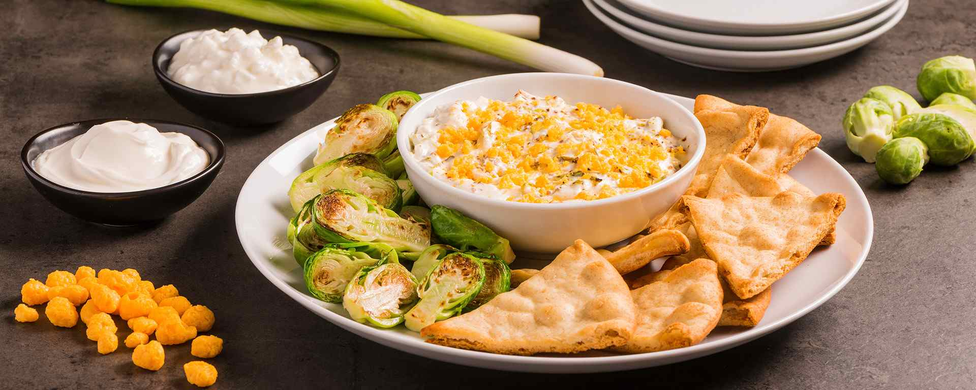 Photo for - Warm Bacon Cheese Dip with Roasted Brussels Sprouts